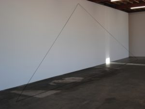 Fred Sandback Untitled (leaning triangle) 1990 acrylic black yarn. Dim variable. Image courtesy the Estate of the artist and Jensen Gallery