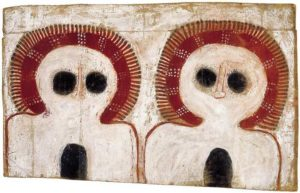 Charlie Numbulmoore  c.1907-1971 Ngarinyin people Untitled (Wanjinas) c.1965 natural earth pigments on cardboard 42 by 66 cm. Image courtesy Tim Klingender Fine Art