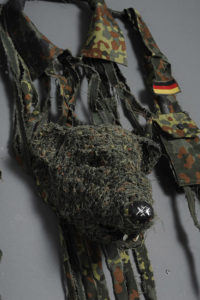 Fiona Hall Mustela lutreola / European mink, Europe, 2012 IUCN threat status: vulnerable German military shirt ('flecktarn' camouflage pattern), teeth, mink paws, bottle cap (Detail). Courtesy of the artist and Roslyn Oxley Gallery, © the artist