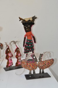 Yarrenyty Arltere Artists, Dulcie Sharpe, Two red birds (right); Dulcie Sharpe, Two eagles; Trudy Inkamala, Little woman with coolamon (back). Image courtesy the artists and Aboriginal and Pacific Art Gallery