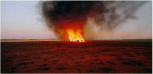 Rosemary Laing Burning Ayer #6, 2003 Type C photo 110 x 224 cm, no 2 from ed of 10 Images courtesy Annette Larkin Fine Art and Tolarno Galleries