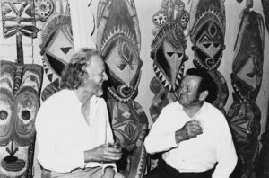 Tony Tuckson former Deputy Director AGNSW and Stan Moriarty with carved figures from Abelam haus tamberan Sydney 1960s  Photo Margaret Tuckson. Courtesy AGNSWArchives