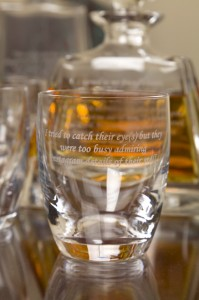 Fayen d'Evie, 12 Step Programme. 2014. etched glass, whiskey. Image courtesy the artist.