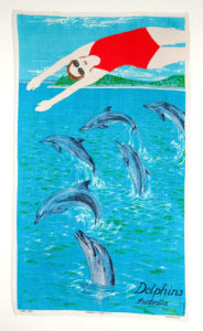 Adrienne Doig Diving with dolphins 2010 applique & embroidery on linen 79x45.5cm. Image courtesy the artist and Martin Browne Contemporary